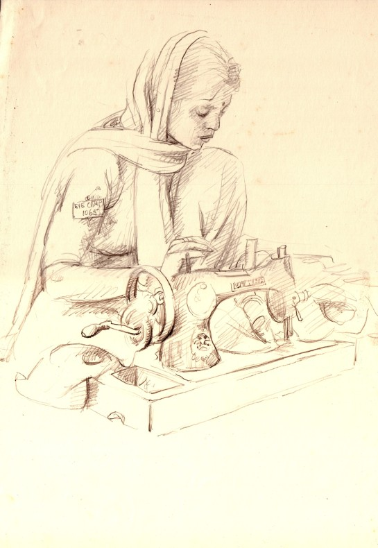A volunteer worker sews bandages