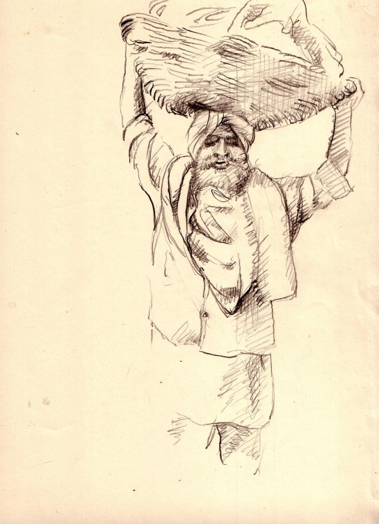 A voluntary worker carrying food - chapattis under a cloth