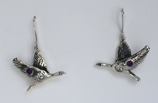 Cormorant earrings: Silver, diamonds, sapphires.